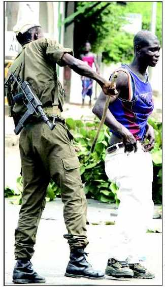 Soldier canes a protester in Lome