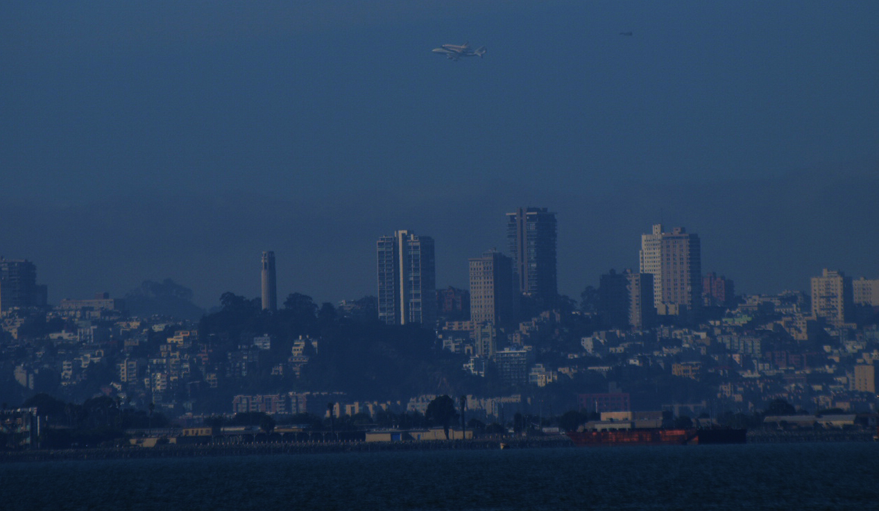 Space shuttle Endeavor makes a pass over San Francisco on its journey to its final resting home in Los Angeles. Photo - Tawanda Kanhema